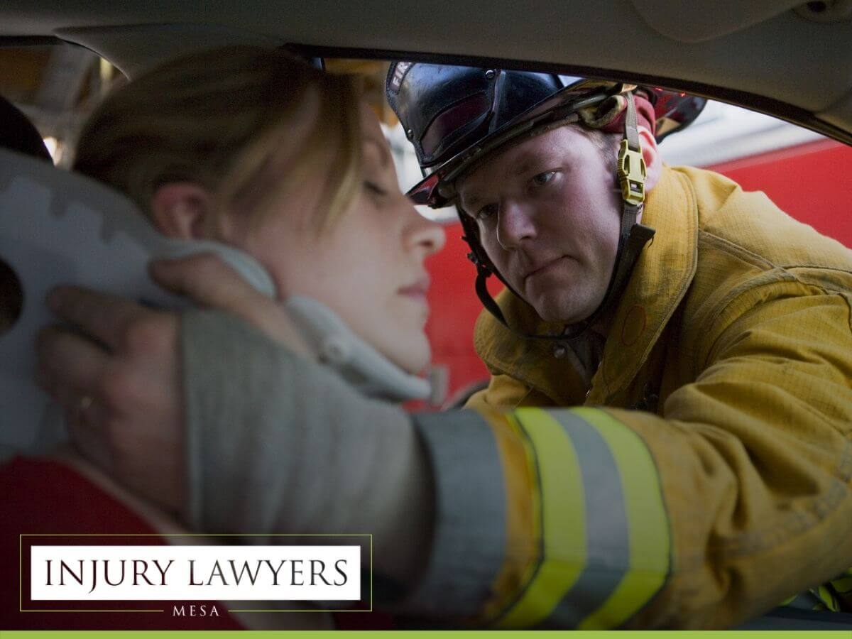 Fireman helping a woman in a car accident