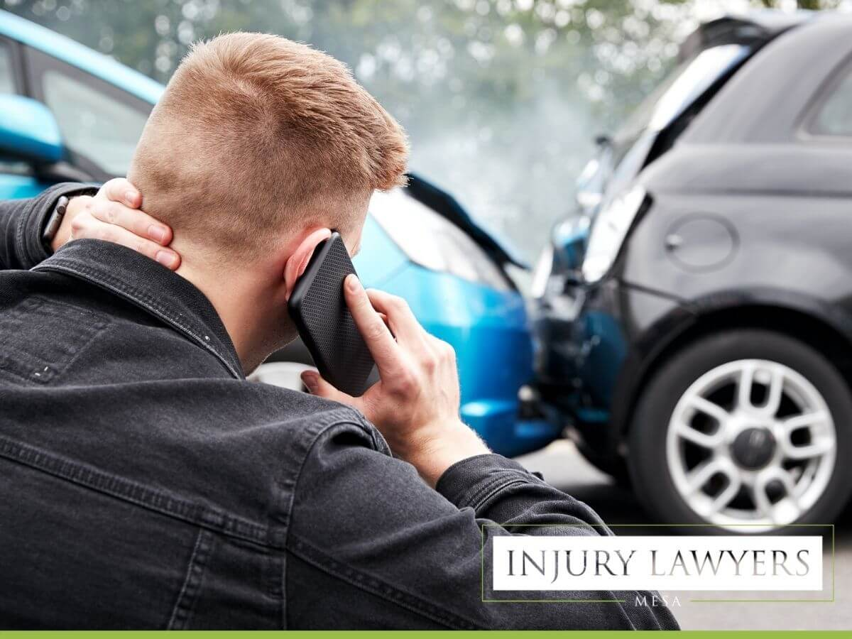 Young male involved in car accident, calling accident attorneys in Mesa, AZ