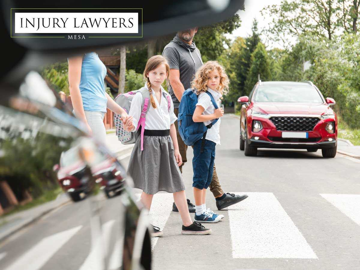 Kids and their parents crossing the road safely to avoid a car accident in Mesa, AZ