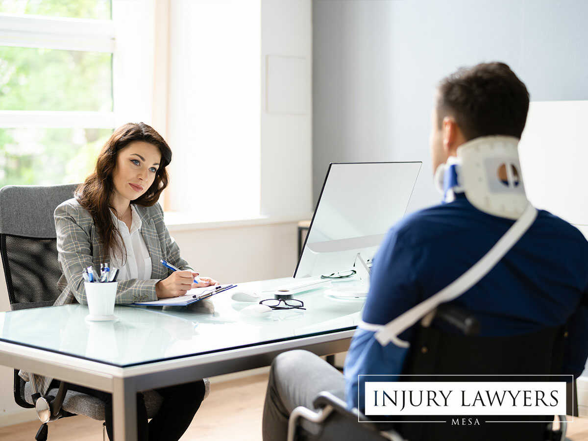 An injured man being advised by a professional personal injury attorney in Mesa, AZ